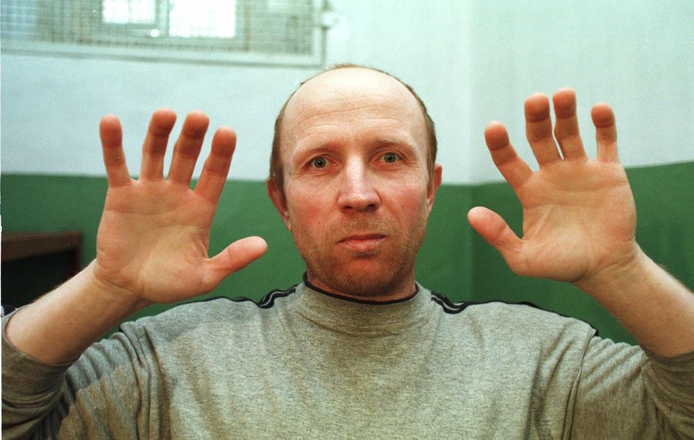 Anatoliy Onoprienko , 39, shows his hands as he comments on the number of people he has killed, in his prison cell in Zhytomyr, Ukraine, Tuesday, March 30, 1999.  The former sailor was declared guilty Wednesday in the worst killing spree in modern Ukrainian history, with a judge reading a lengthy verdict documenting 52 slayings.  The detailed verdict took the whole court day to read, and sentencing for Onoprienko was not expected to be announced until Thursday.  (AP Photo/Efrem Lukatsky)
