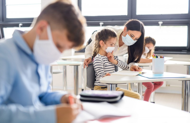 group-of-children-with-face-mask-back-at-school-af-USFLSB8-min-scaled