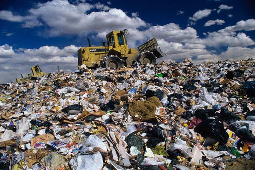 ca. 1991 --- Bulldozer on Trash Dump --- Image by © David Sailors/CORBIS