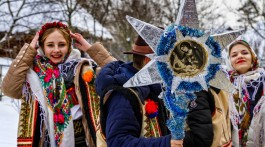 Uzhgorod, Ukraine - January 15, 2017: Female folklore collective performs during the seventh ethnic festival Christmas Carols in the old village. During the festival, visitors can familiarize with a variety of Christmas customs, caroling and celebrations edge.