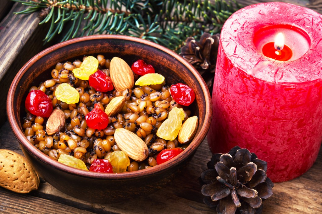 Traditional Christmas porridge, kutya and lighted candle